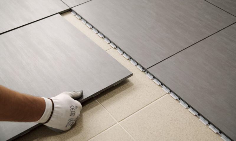 Cambiare pavimento facile solo con clip tile for Piastrelle linoleum bagno